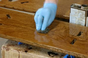 apply oil with a non woven abrasive pad