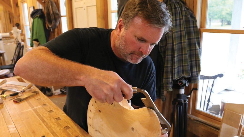 using a drawknife to refine the edges