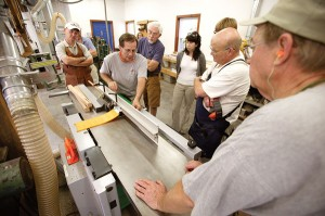 Here, Mehler shows his students how to run tapered legs on the jointer.
