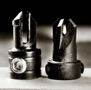 The area between the cutters carries the waste from the countersink.