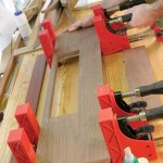 """Glue the 3⁄4"""" strip back to the apron. Make sure you line up the grain as best you can. On my apron, I positioned my cutline so it would run through some straight quartersawn grain on the apron. That helped conceal the joint line on the finished piece."""