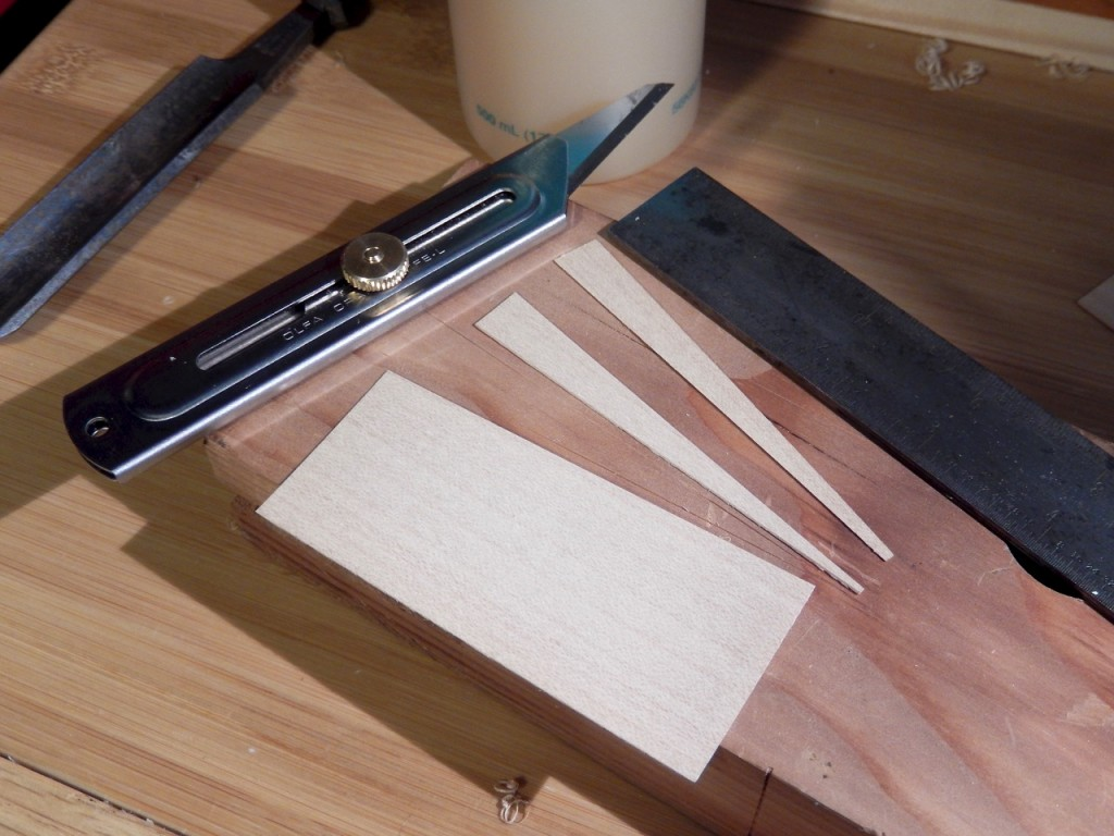 Cutting the shims form a small piece of veneer