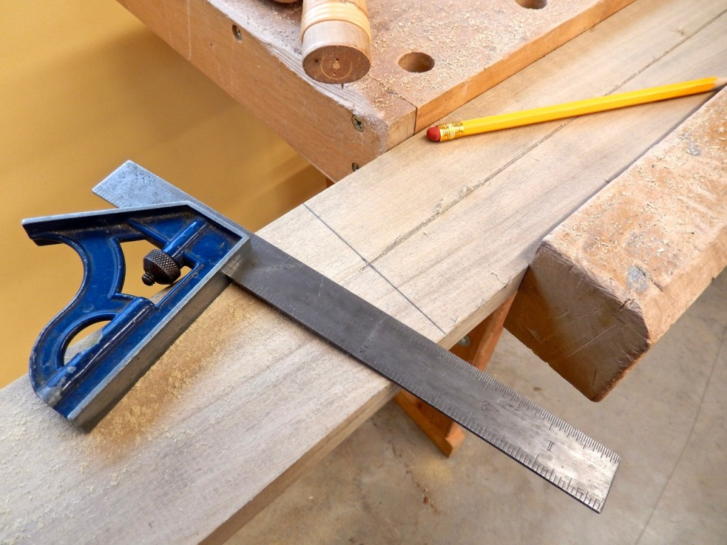 Marking the location of the first cross cut at the end of the rip cut that split the board in the middle.
