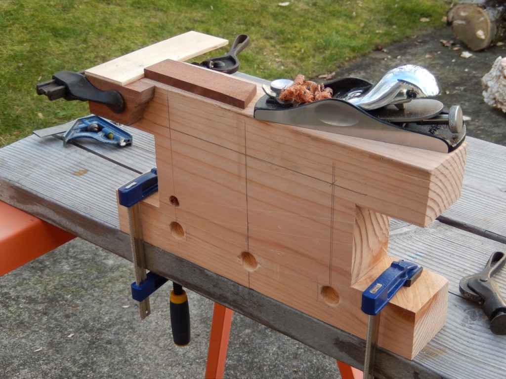 A simple shop made T- square is all you need to keep a workpiece put for planning