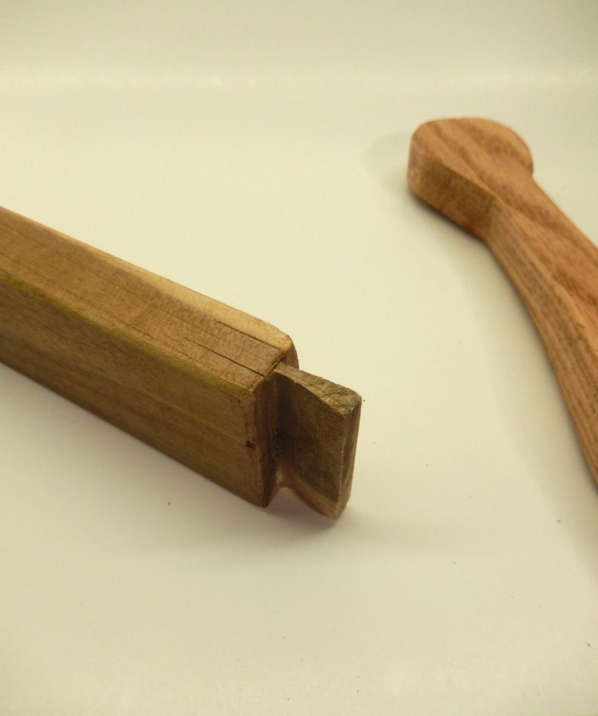 In a few cases a student over cut his or her tenon and in two cases we had to glue a wood shim over and after the glue dried to re-shape the tenon.