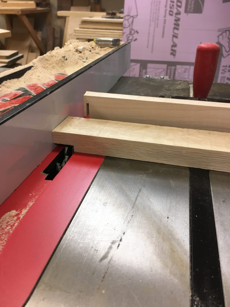 cutting the rabbeted door frame tenon cheek on table saw with dado blade