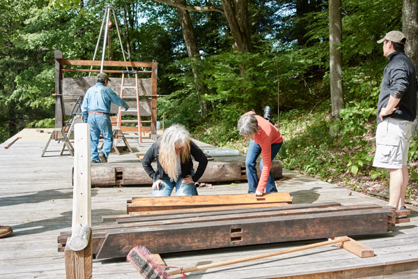 """Reassembling """"Reminiscence of Heirinji"""" on Toshio's property. Toshio is in the background, his son, Shobu, is in the foreground, and Toshio's partner (and fellow artist) Laure Olender is with me in the middle, looking at the joinery."""