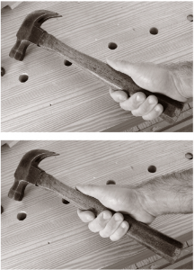 Gripping the hammer at the end of the handle (at top) increases the power in your stroke. Gripping it up at the swelling (below) reduces your power and can increase your accuracy. Note the extended thumb on both grips – this will also improve your accuracy.
