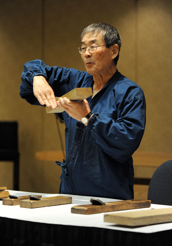 Toshio Odate discussing Japanese planes at Woodworking in America 2009, in Valley Forge, Penn. Photo my Megan Fitzpatrick
