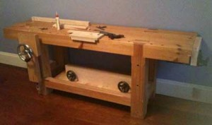 My Roubo-style bench at home, with a Benchcrafted Glide vise (and Benchcrafted twin-screw stored underneath).